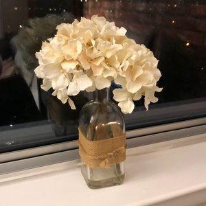 Faux flowers in glass vase